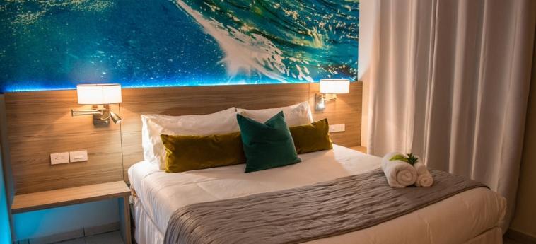 Hotel Perle D'or: Habitación de huéspedes ARUBA