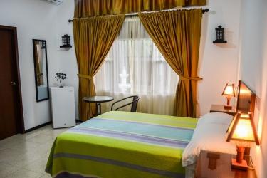 Hotel El Escalon: Habitación de huéspedes GUAYAQUIL