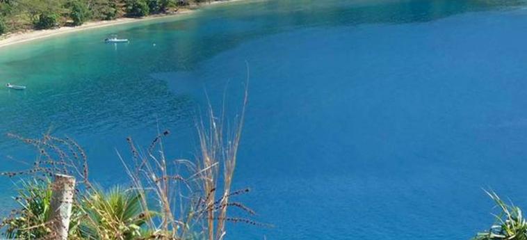 Dolphin Bay Divers Retreat: Spiaggia ISOLE FIGI
