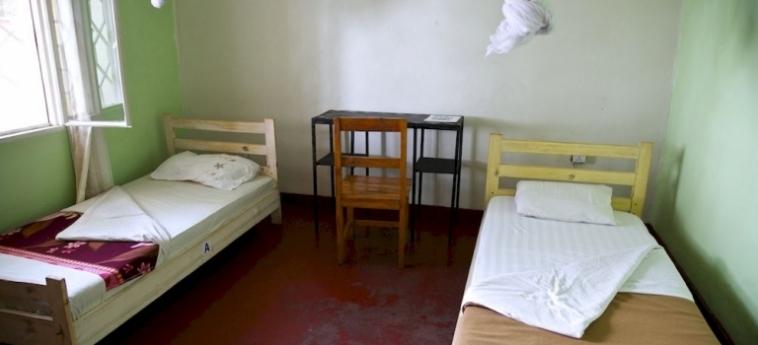 Discover Rwanda Youth Hostel: Chambre de Luxe KIGALI