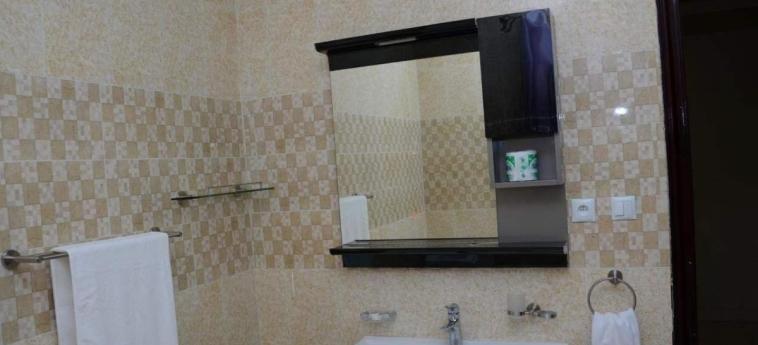 Grazia Apartments: Badezimmer KIGALI