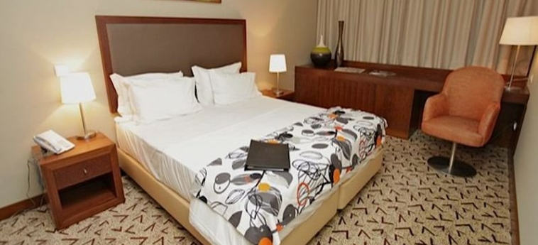 Skyna Hotels: Schlafzimmer LUANDA