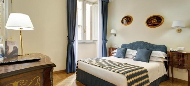 Hotel Welcome Piram: Schlafzimmer ROM