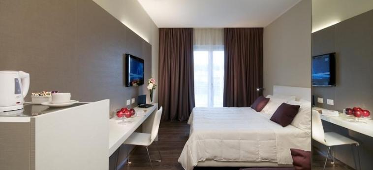 Hotel Golden Tulip Rome Airport Isola Sacra: Schlafzimmer ROM