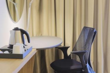 Hotel Holiday Inn Express Singapore Orchard Road: Zona giorno SINGAPORE