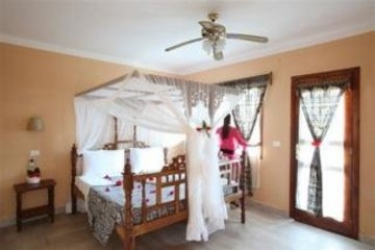 Hotel Ora Palumbo Reef Resort: Bedroom ZANZIBAR